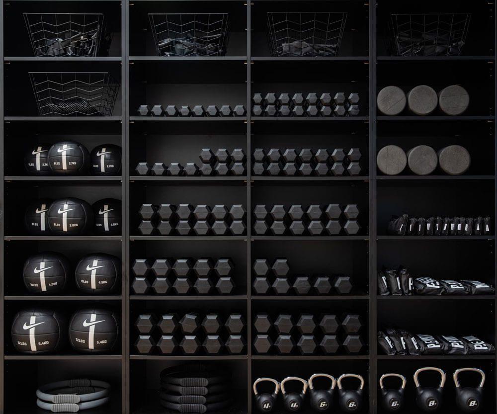 Pilates equipment on black shelving